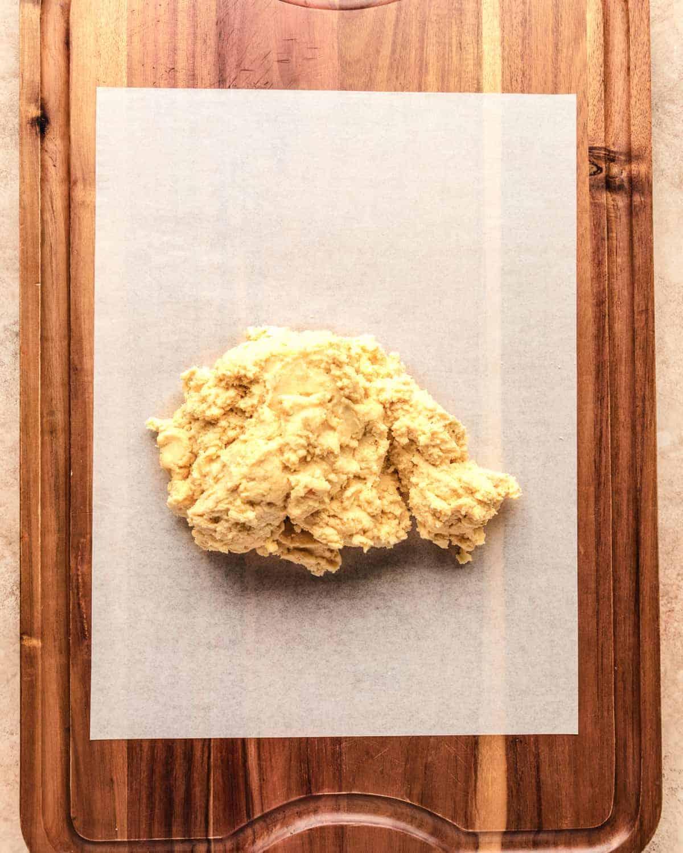 greek cookie dough on a cutting board