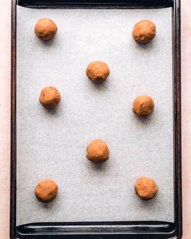 malt ball cookie dough on a baking sheet
