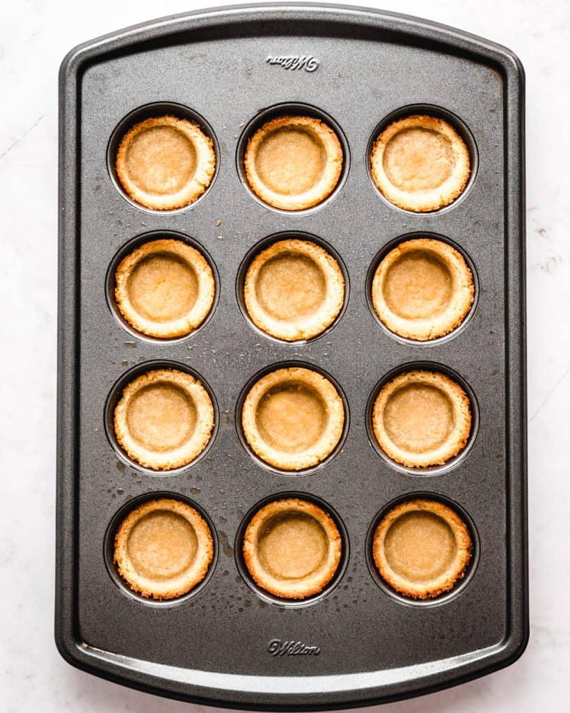 overhead of sugar cookie cups in a mini muffin tin