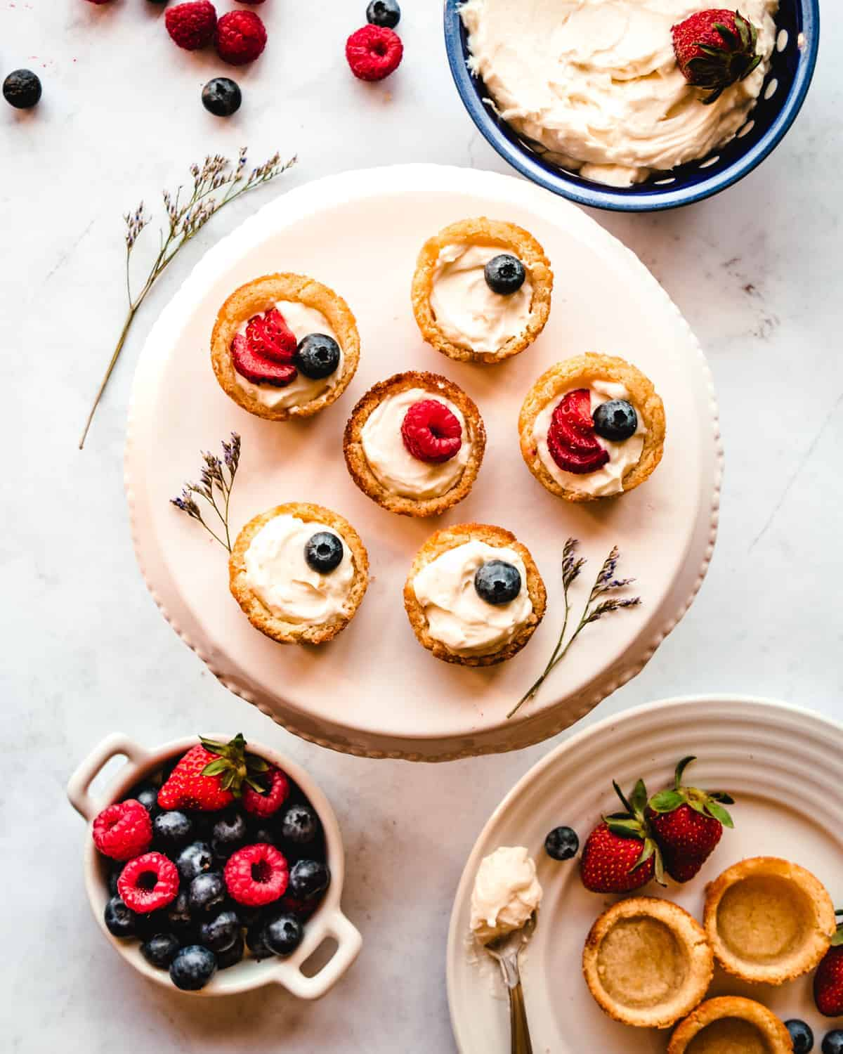 sugar cookie fruit tarts on a cake stand