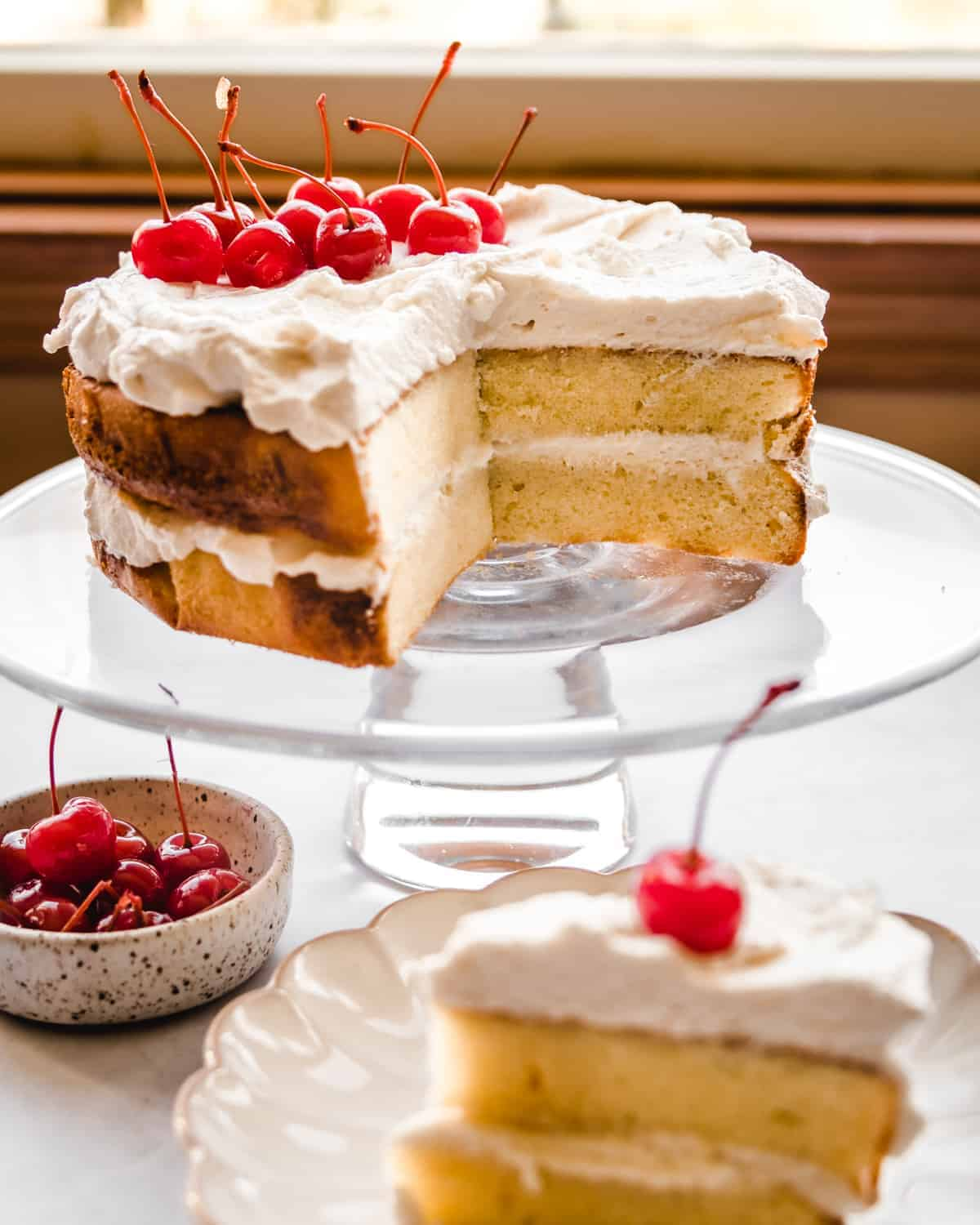 almond layer cake with a slice taken out of it