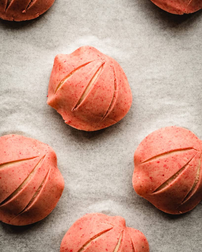 concha dough with strawberry topping proofed