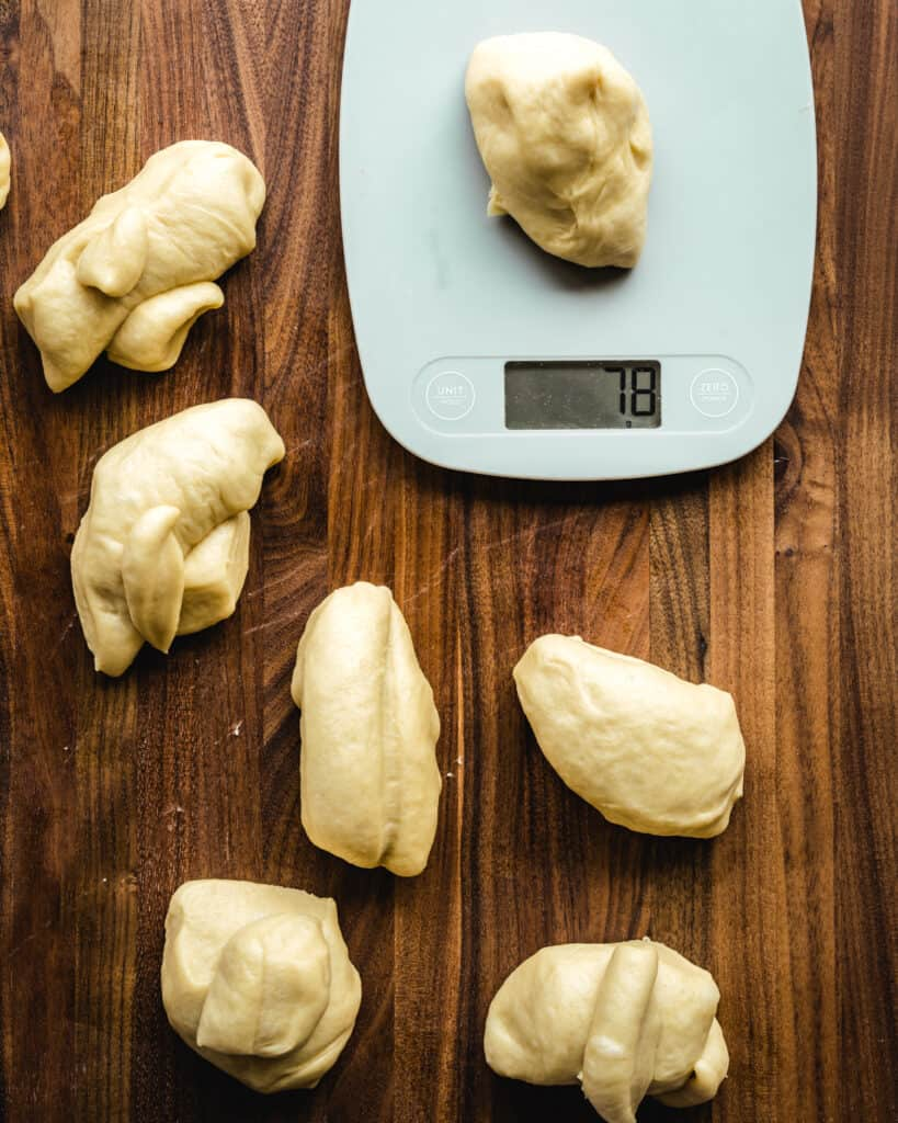 divide conchas dough into equal portions using a kitchen scale