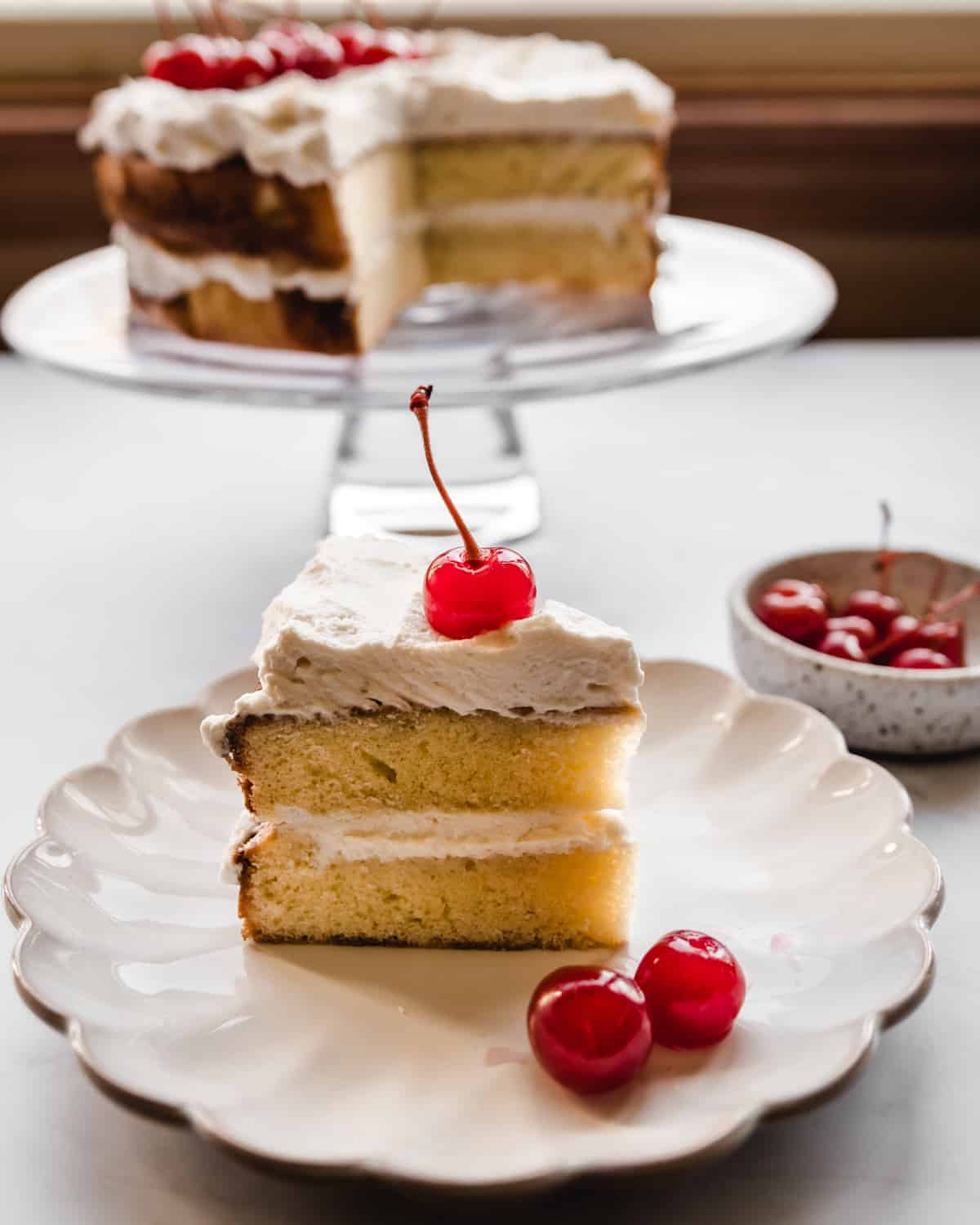 layer cake with cherry whipped cream