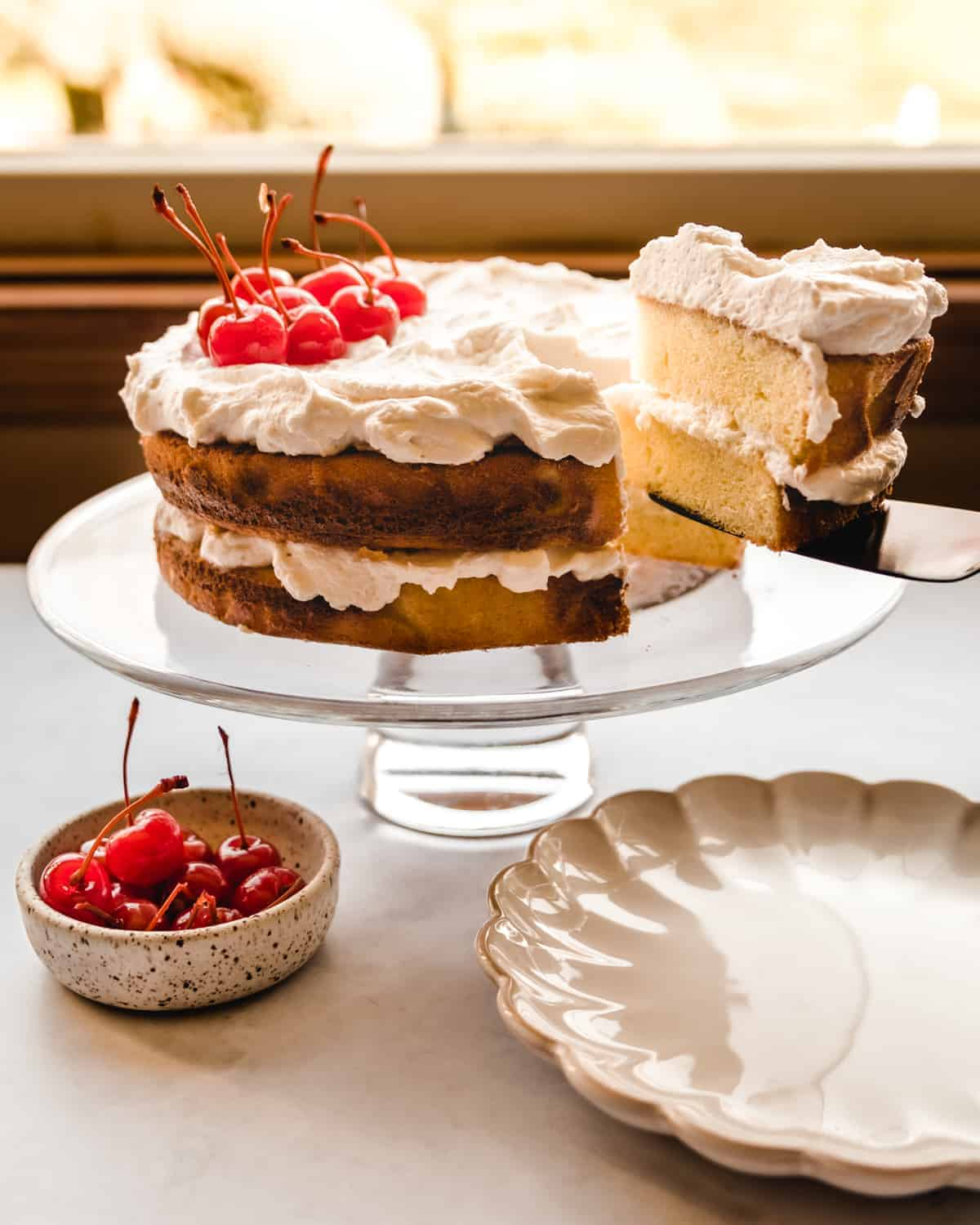 serving a slice of almond layer cake