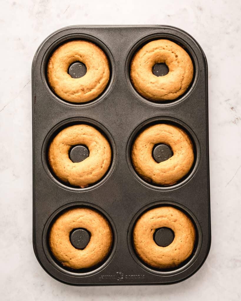 freshly baked donuts in donut pan