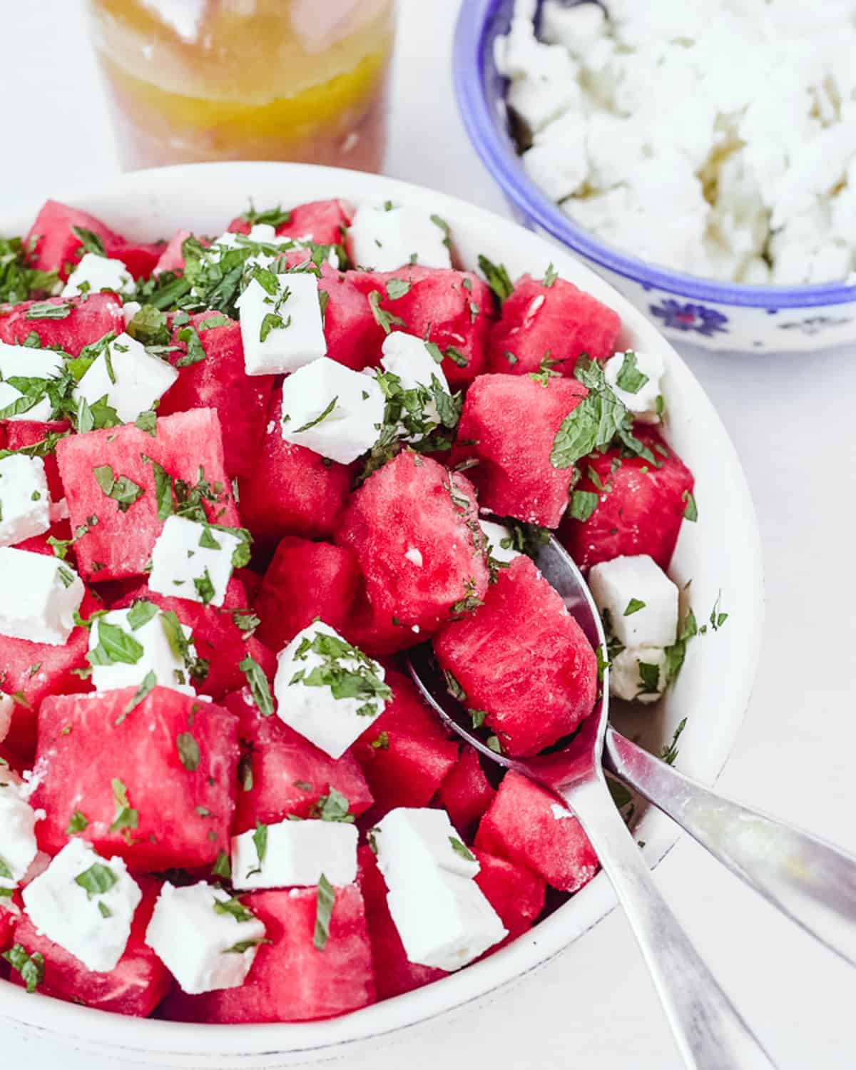 bowl of cited watermelon with chunks of feta and mint