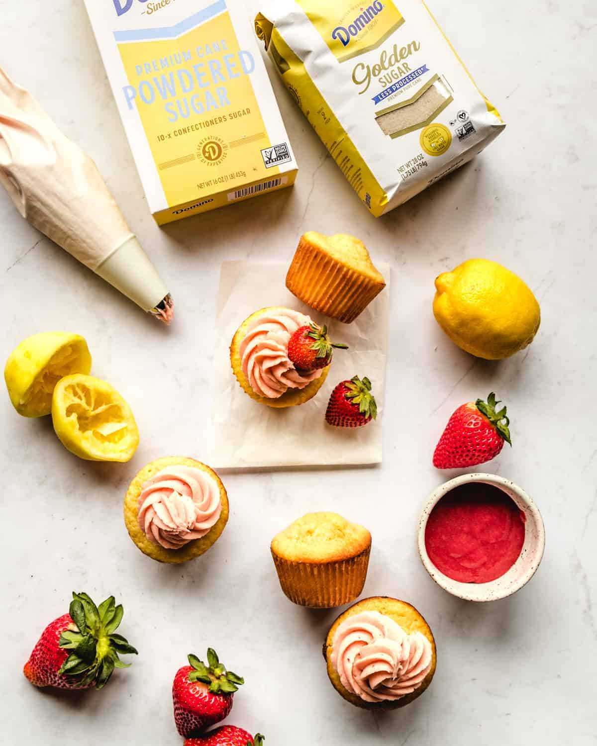 overhead view cupcakes with lemon and strawberries