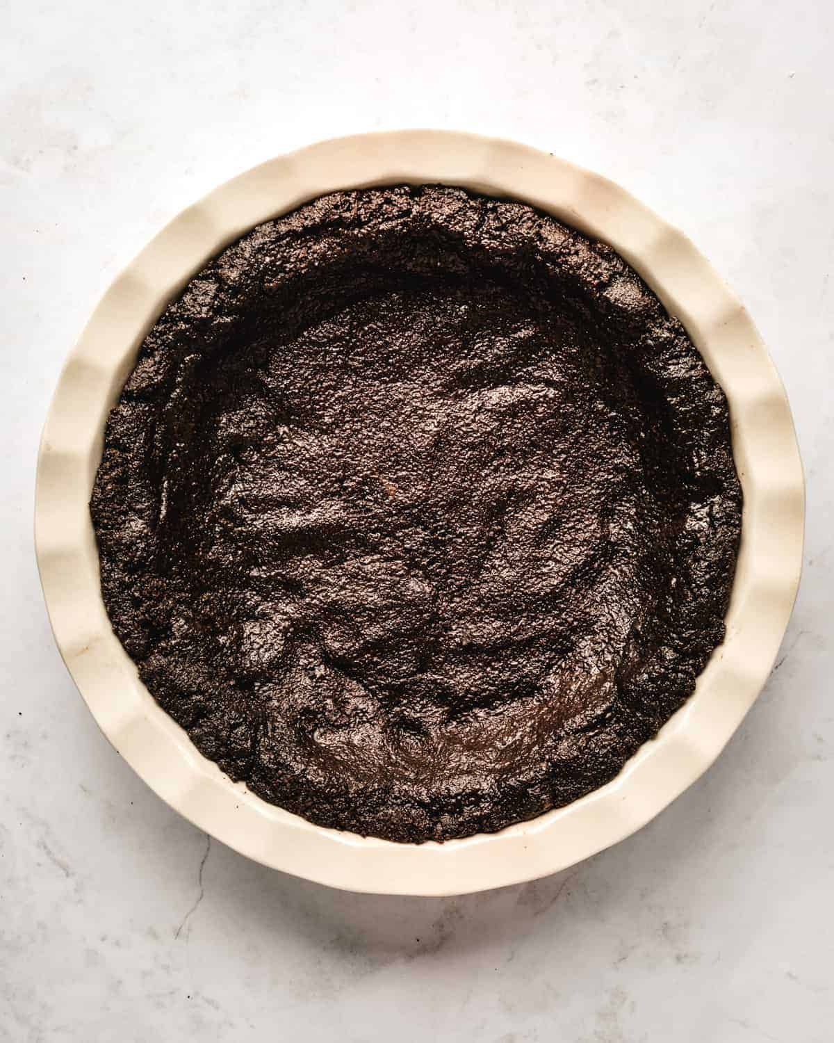 This quick and easy No Bake Nutella Pie starts off with a quick and easy crust made from crushed Oreo cookies.