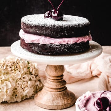You'll be shocked at how easy the recipe is for this chocolate torte with bourbon cherry whipped cream and a dusting of powdered sugar.