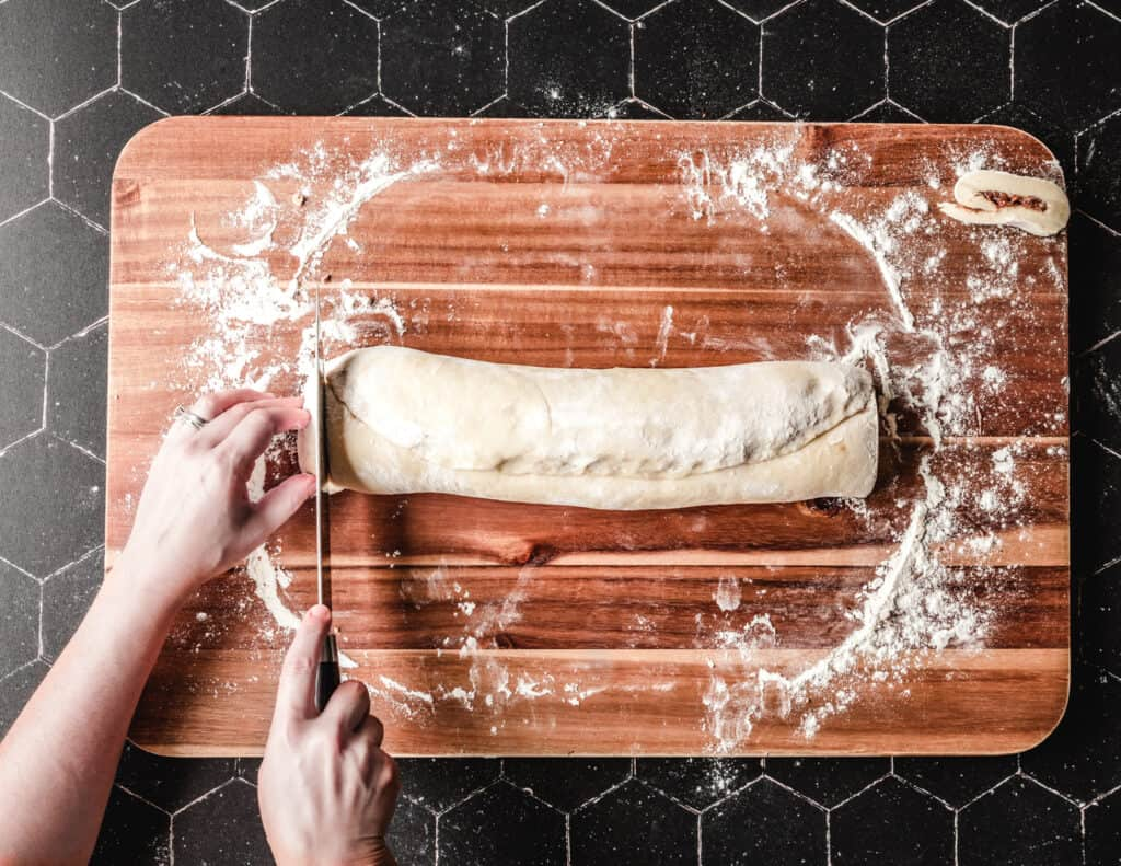 To make sure your cinnamon rolls cook evenly, cut the ends off.