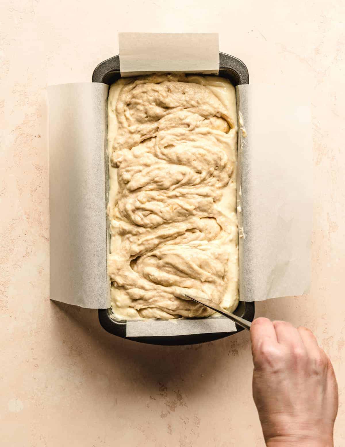 Swirl the cream cheese banana bread batter before baking.