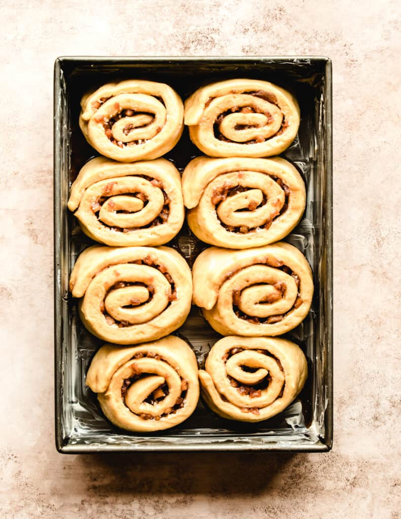 Let your apple pie cinnamon rolls rise once you've put them into the baking dish.