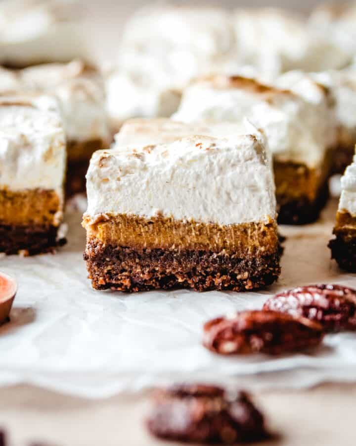 These homemade sweet potato pie bars all have a generous layer of homemade marshmallow fluff.